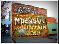 Layers of painted wall signs blend together on this building in Rocky Ford, Colorado