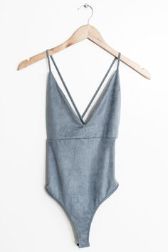 Details Size Shipping • 90% Polyester 10% Spandex • Soft faux suede cross back bodysuit • Hand Wash • Line dry • Made in the U.S.A • Measured from small • Leng