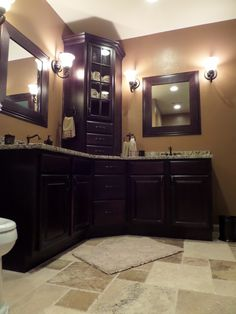 Custom Corner vanity, love the vanity and the tile.  Would like larger mirrors.... and maybe different lighting.
