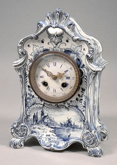 A late 19th Century Delft pottery cased mantel clock, the 3.25ins diameter…