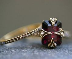 Garnet Engagement and Wedding Ring. GORGEOUS...I may have just changed my mind about fancy rings.