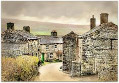 Burtersett, England.This village (Wensleydale) is just charming beyond belief. I want to go and see what is through that green door.. =)