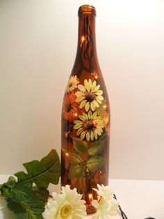 Lighted Wine Bottle Amber Daisy Flowers Hand Painted Recycled 750ml. $30.00, via Etsy.