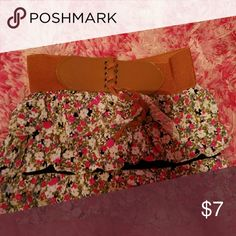 Mini skirt Floral printed with a built in belt on the waist.  30% off bundles 3 items or more  Free shipping on bundles of $20 or more Skirts Mini