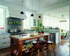 Loving the olive oil display, the island and beautiful sink, flooring and lights | #cultivateit