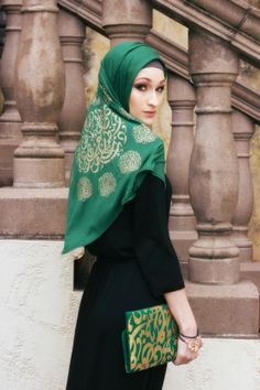 Green hijab with gold calligraphy  Unsure of vendor but have seem similar on mainstream hijab sites