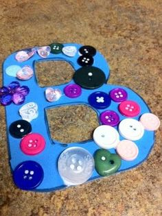 """B is for Button. Could also do a scavenger hunt and hide the letter """"B"""" all over the house. How many can we find? Repeatedly say """"Buh, B"""" to help learn """"B"""" sound. Also teach with """"B"""" sign (from the sign language alphabet). Letter B Activities, Preschool Letter Crafts, Alphabet Letter Crafts, Abc Crafts, Preschool Projects, Daycare Crafts, Preschool At Home, Classroom Crafts, Preschool Activities"""