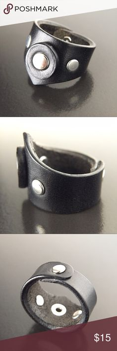 "Genuine Leather Ring Black Fuji Rivet Stud Sz 8.5 A bold wide ring, cut, fastened, and finished all by hand. Crafted from genuine cowhide leather. Black with nickel plated rivets. About 1/2"" at its narrowest point, a scant 7/8"" at its widest, size 8.5 on my sizer. Treat leather jewelry carefully as you would leather shoes, bags, etc: keep dry, buff with a soft cloth, and condition as needed. Leather weathers, distresses, and ages with time and wear. This is one of the things I love about…"