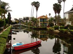 The Venice Canal Historic District is a district in the Venice section of Los Angeles just two block east of the Pacific Ocean. The district is noteworthy for its enclave of homes built around six slim man-made canals where residents and ducks paddle by. Visit www.xplorela.com