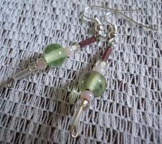 These adorable earrings are handmade with deliciously apple green glass beads, soft pink and deep purple bugle beads as well as pink and clear Czech glass e-beads! Secured with fish/french hook wire