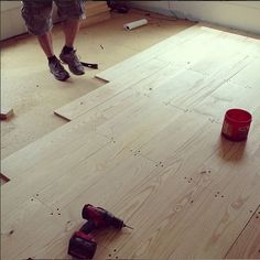 DIY Wood Floors with 1x8s. Seems more advisable than plywood. Also, StainStick for applying poly.