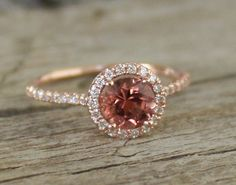 <3 Rubelite Pink Tourmaline<3  Diamond Halo by Studio1040 on etsy.com , in the 14k yellow gold (NOT the rose gold in the picture) this is gorgeous! I'm absolutely in love with this design and stone!!!!!!!!! Though I'd probably chose clear topazes instead of diamonds for the accents.