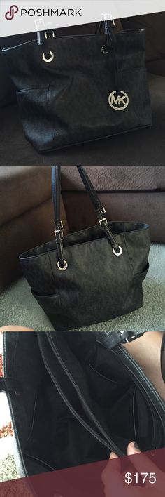 Michael kors jet set tote Black and silver perfect condition. Has been used but no flaws. Side pockets. Middle zipper pockets inside w compartments. Cheaper on M!! MICHAEL Michael Kors Bags Totes