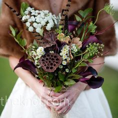 #rustic wedding #fall wedding A rustic mix of calla lilies, aged lotus pods, feathers and Queen Anne's lace, and kept warm in a vintage fur stole