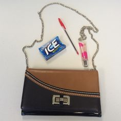 """White House Black Market Clutch Best clutch I've ever seen. Has everything you need and more! Made like a wallet with room for bills, coins, lip gloss, etc. Patent leather. Colors brown and cognac. NWOT. Excellent condition. 5""""x9"""". Silver chain. White House Black Market Bags Clutches & Wristlets"""