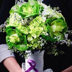 One of my anti-floral brides. We still created a gorgeous bouquet using mostly greens, kale and mini green hydrangea. Also note the homage purple ribbon. She's a cancer survivor. So cool!!