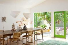 The room may be mellow, but the doors are a bright green — a lovely detail that ties together the indoors and outdoors