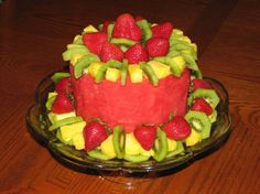 I made this fruit cake for my husbands birthday dinner, as he is not fond of cake. This cake is made entirely of fresh fruit, which is cleverly arranged in the shape of a cake (basically a carefully arranged fruit salad). It was a big hit with my hubby and the rest of our family, especially the kids. Its healthy, people can pluck off whatever fruit they desire and cut whatever size slice of watermelon they like, and the types of fruit used are interchangeable. Creative substitutions are w...