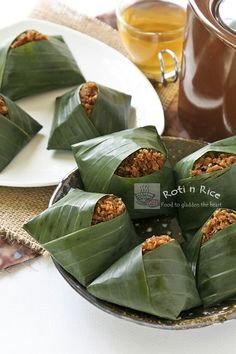 Pulut Inti is a traditional Malaysian dessert of steamed glutinous rice with a sweet coconut topping. They are usually wrapped in banana leaves. #malaysianfood #glutinousrice #coconut #dessert