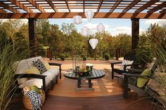 Outdoor living space with overhead painted trellis, potted plants and low maintenance outdoor table and chairs