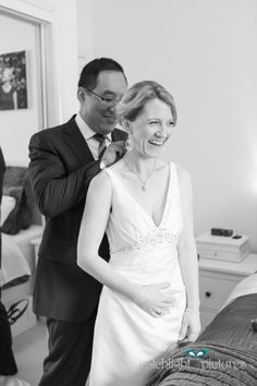A last minute wedding present from the groom to his bride - a STUNNING pearl pendant that perfectly matched her slinky ivory gown