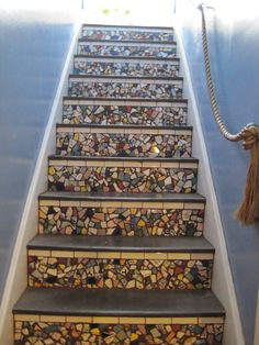 These are the back stairs in our year old house. I cut white tiles with a tile saw for the top part of each riser and used broken plates, cups, and tile along with glass gems on the rest. The rope was put up by the previous owner and I gilded it. Stair Risers, Stair Steps, Mosaic Stairs, Tile Stairs, Mosaic Wall, Tile Saw, White Tiles, Stairways, My Dream Home