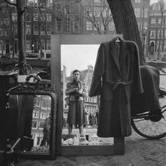 1950s. Yard sale on the bank of a canal in Amsterdam. #amsterdam #1950 Photo:  Eva Besnyö