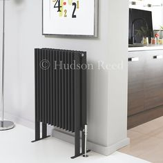 The 900mm x 570mm Double Panel Fin Radiator by Hudson Reed in High-Gloss Black is striking and contemporary by design.