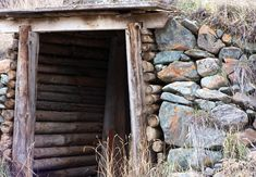 How to Build a Root Cellar - I'm just interested in the wood opening and rock walls