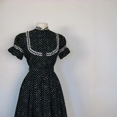 http://www.etsy.com/listing/53540462/1950s-print-dress-poppy-print-full-skirt