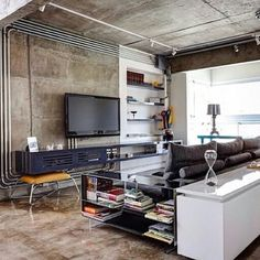 here theyv used white track lights on the exposed concrete ceiling. Which also works. Industrial Interior Design, Industrial House, Industrial Interiors, Living Room Spotlights, Country Farmhouse Exterior, Loft Design, House Design, Living Room Designs, Living Room Decor