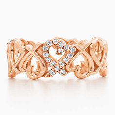 Paloma Picasso® Loving Heart band ring in 18k rose gold with diamonds.