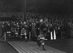 13 November 1945: Russian team Moscow Dynamo walk out onto the pitch before their friendly match against CHELSEA at Stamford Bridge. It is the Dynamo's first visit to Great Britain and an estimated 100,000 people turned up to watch the match...