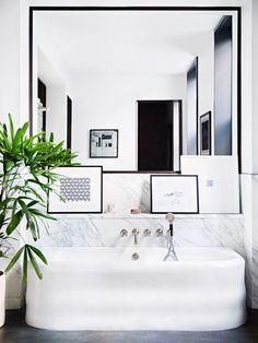 Modern bathtub in a black and white bathroom