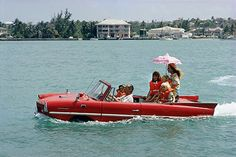 Slim Aarons, Film producer Kevin McClory and his family in an 'Amphicar', harbour at Nassau, 1967.