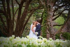 Wedding kiss at Botanical gardens. New Zealand wedding photography http://www.paulmichaels.co.nz/ PaulMichaels Wellington photographers.