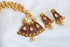 Ruby polki necklace with kundan pendant and gold ball chain. Comes with matching earrings.