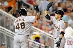 WASHINGTON, DC - AUGUST 22: Joe Panik #12 of the San Francisco Giants celebrates with Pablo Sandoval #48 after hitting a three-run home run in the fourth inning against the Washington Nationals at Nationals Park on August 22, 2014 in Washington, DC. (Photo by Greg Fiume/Getty Images)