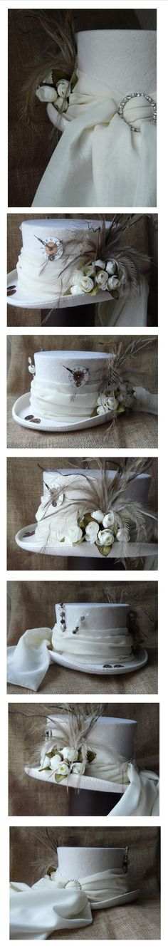 The Ivory Express, Steampunk wedding hat with train, antique watch assemblage, hatpins, flowers and feathers. Ratty Tat Hats' custom tailor made orders can be placed via website.