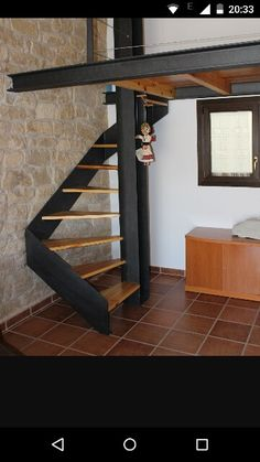 Spiral staircase with wooden steps and design mezzanine in lacquered steel - Spiral Staircase design lacquered Mezzanine spiral staircase steel Steps wooden Loft Stairs, House Stairs, Open Stairs, Steel Stairs, Spiral Staircase, Staircase Design, Staircase Ideas, Staircases, Escalier Design