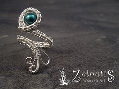 Compliment any outfit when you wear this silver wire wrapped adjustable ring with nestled teal glass bead.The hand wrapped, woven and coiled, permanently colored copper wire is tarnish resistant. Size 7 - adjusts to fit sizes 6 & 8 Band . Wire Jewelry Rings, Jewlery, Handmade Rings, Handmade Jewelry, Wire Wrapping Crystals, How To Make Rings, Imitation Jewelry, Wire Wrapped Rings, Wire Weaving