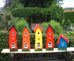 Cute and colourful hand-crafted birdhouses.  So cute!  Would love one of these =) I'M LINING MY RAILING