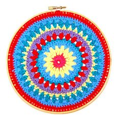 The free crochet pattern for this mandala made inside of an embroidery hoop is available from Mitten & Makings.