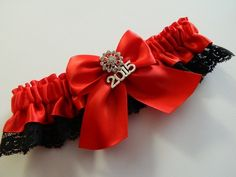 An elegant prom garter red satin black Rachel Lace This prom garter is embellished with a bow rhinestone and 2015 charm .  ~~~ ~~My wedding garter are made-to-order and comfortably stretch from 12 to
