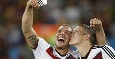 German forward Lukas Podolski cuddled up to teammate Bastian Schweinsteiger to snap a selfie after toppling Argentina 1-0 in the World Cup f...