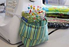 Sewing Machine Pincushion - Very clever scraps collector and I love the heart topped pins too.