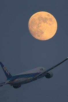 Airliner with moon (by SHO AirTeamImages)