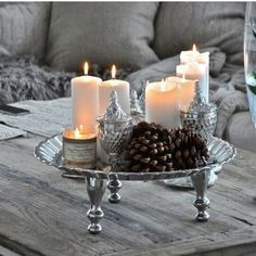 Candles & pinecones on silver.