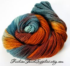 Autumn, Hand Painted Yarn in Shades of Teal, Orange and Brown. $18.00, via Etsy.