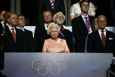 Britain's Queen Elizabeth and Prince Phillip attend the opening ceremony of the London 2012 Olympic Games with International Olympics Committee President Jacques Rogge (L), German Olympic Sports Confederation (Deutscher Olympischer Sportbund, DOSB) President Thomas Bach (2nd L) and Archbishop of Canterbury Rowan Williams (back C) at the Olympic Stadium July 27, 2012. REUTERS/Kai Pfaffenbach